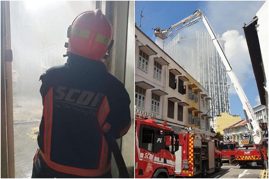 SCDF personnel fighting a fire at a shophouse in Outram Park on June 15, 2021.