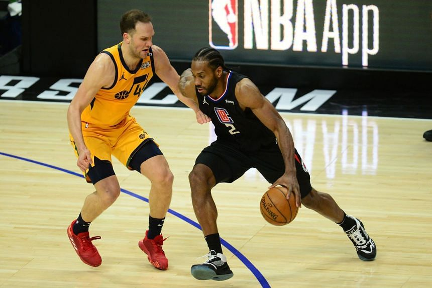Kawhi Leonard (right) and Bojan Bogdanovic at the 2021 NBA Playoffs at Staples Center in Los Angeles, on June 14, 2021.