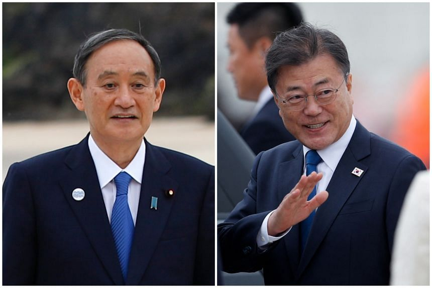 Japanese Prime Minister Yoshihide Suga (left) and South Korean President Moon Jae-in only exchanged greetings before the start of one of the formal meetings at the G-7 summit.