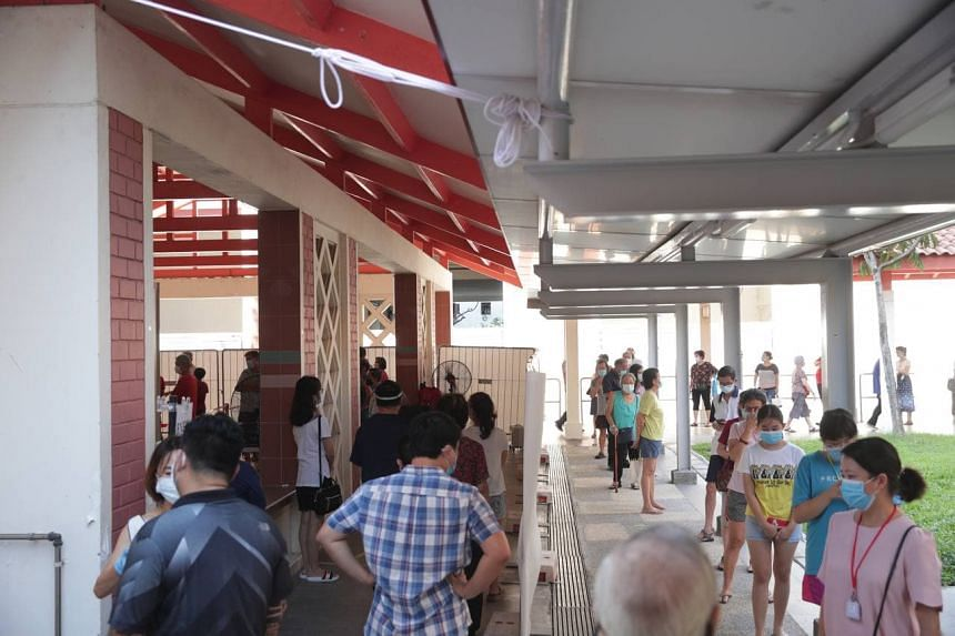 People queueing at the temporary Covid-19 testing area set up at Block 125A Bukit Merah View on June 15, 2021.