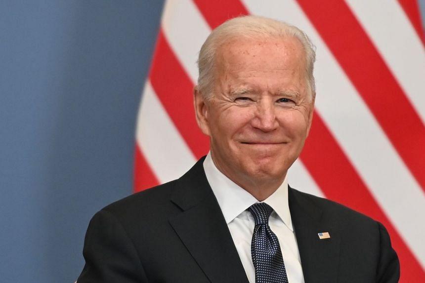 US President Joe Biden smiles in Geneva ahead of a meeting with Russian counterpart Vladimir Putin.