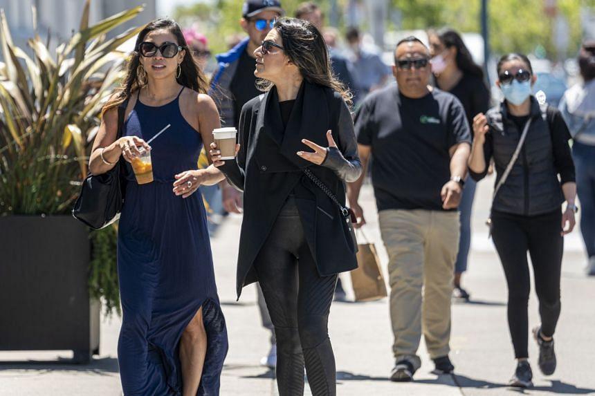 People walk along the Embarcadero in San Francisco, California, on June 15, 2021.