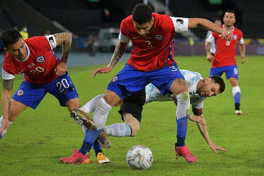 Argentina's Lionel Messi vying for the ball with Chile's Charles Aranguiz (left) and Guillermo Maripan at the Nilton Santos Stadium. The Barcelona forward scored his 73rd international goal in the 1-1 draw.