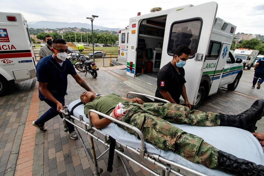 Medical workers bring an injured soldier on a stretcher in a hospital following a explosion in Cucuta, Colombia, on June 15, 2021.