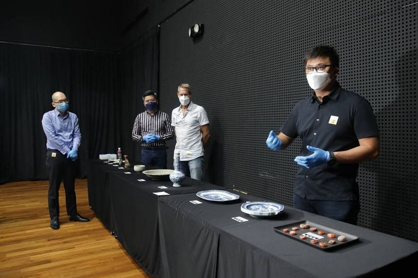 Mr Michael Ng (right) showing artefacts to members of the media at Malay Heritage Centre on June 16, 2021. With him are (from left) Mr Yeo Kirk Siang, Mr Alvin Tan, and Dr Michael Flecker.