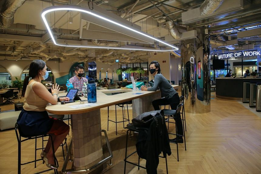 People working at a co-working space in JustCo at The Centrepoint.