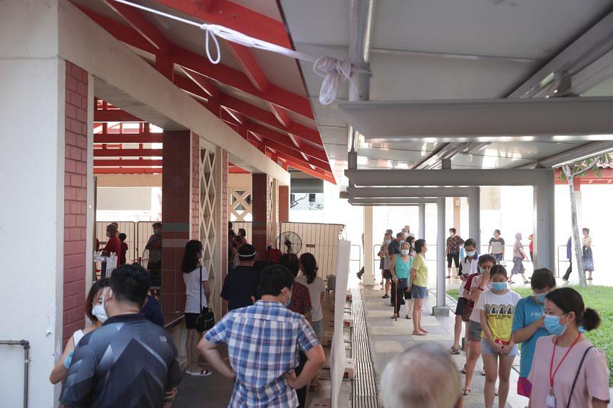 People queueing up for Covid-19 swab testing at Block 125A Bukit Merah View, on June 15, 2021.