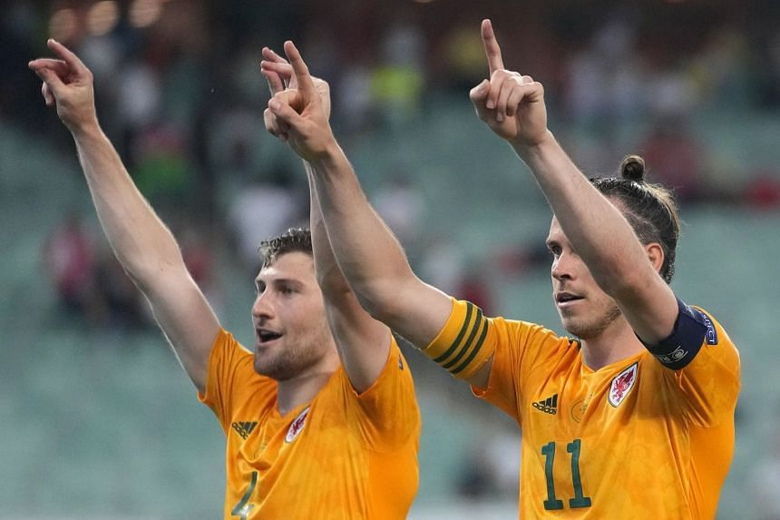Wales' Ben Davies (left) and Gareth Bale celebrate after winning their match against Turkey.