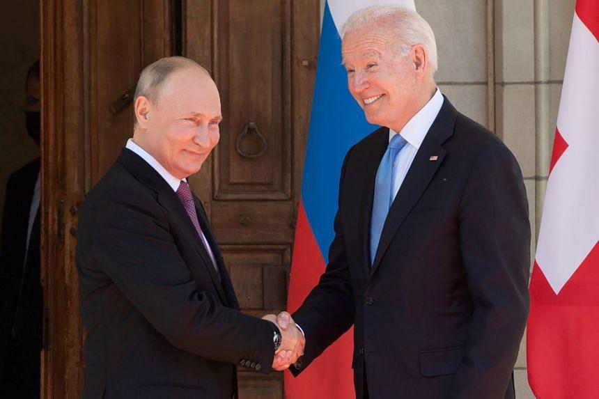 US President Joe Biden and Russia's President Vladimir Putin shake hands as they arrive for the US-Russia summit in Geneva, Switzerland.