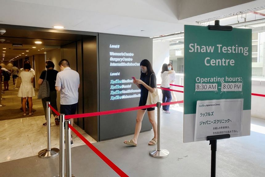 People who visited Ion Orchard queueing to enter a testing centre at Raffles Medical at Shaw Centre on June 12, 2021.