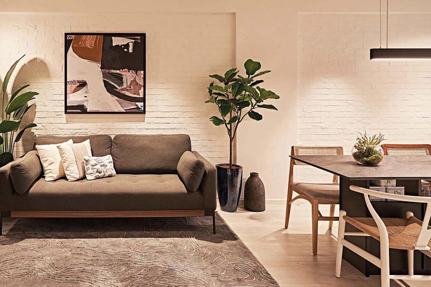 The cosy living and dining area is finished in whitewashed faux brick wall panels.