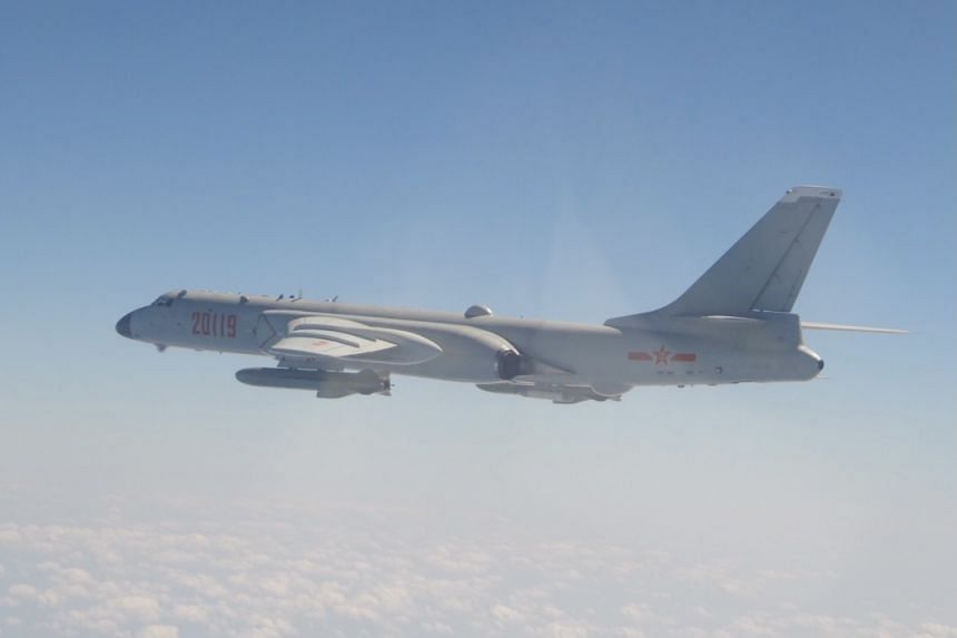 An undated handout photo made available by the Taiwan Ministry of National Defense shows a PLA H-6 bomber flying in an undisclosed location.