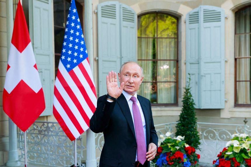 Russia's President Vladimir Putin waves as he leaves the Villa La Grange after his summit with the US President Joe Biden in Geneva.