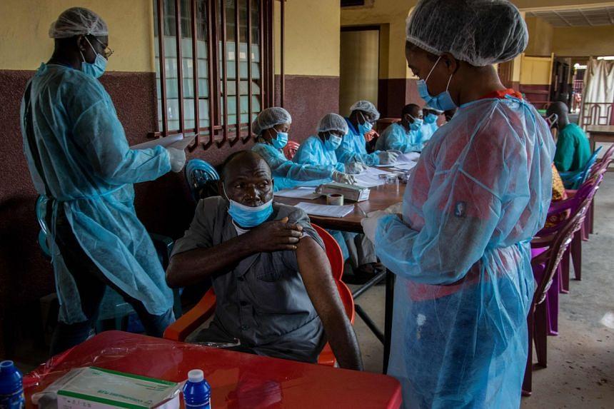 A hospital worker preparing to get his anti-ebola vaccine in N'zerekore, Guinea, on Feb 24, 2021.