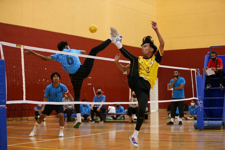 Jurongville Secondary School (in yellow) and Bartley Secondary School during the B Division boys' sepak takraw final on April 21, 2021.