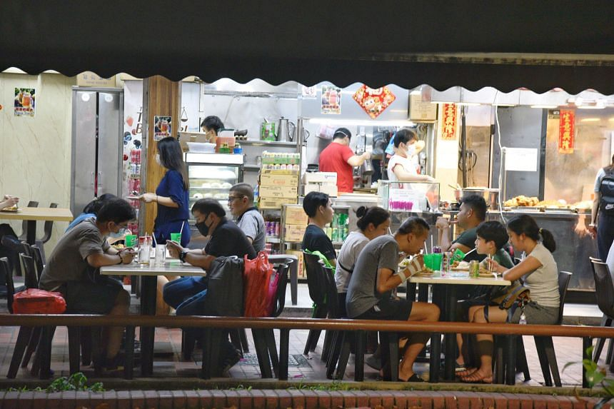 People eating at a coffee shop in Serangoon Central in May this year.