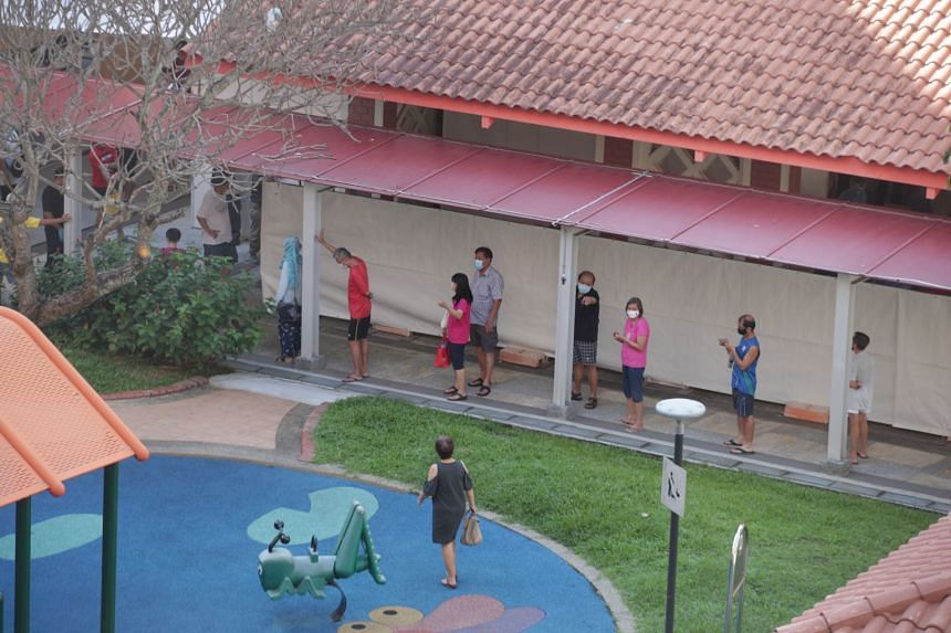 Long queues formed at the temporary Covid-19 testing area set up at Block 125A Bukit Merah View after the site was opened to residents.