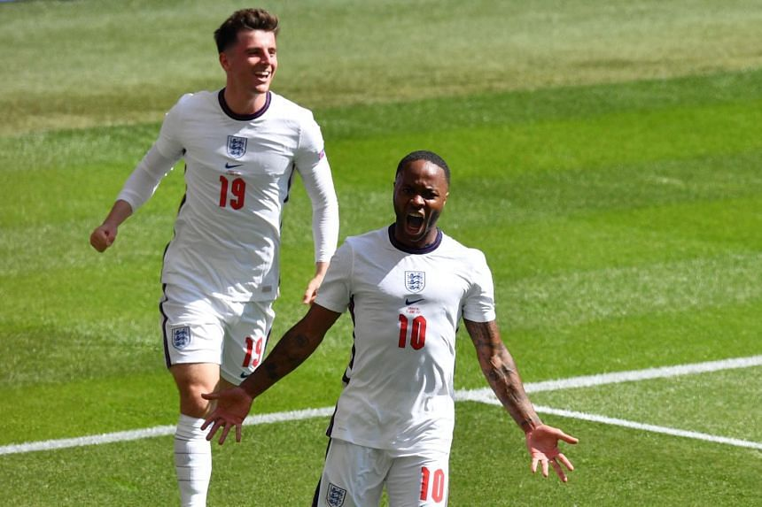 England's Raheem Sterling (right) and Mason Mount celebrate a goal against Croatia on June 13, 2021.
