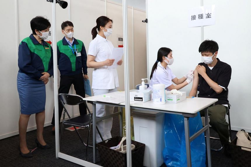 Tokyo governor Yuriko Koike (left) inspecting the vaccination exercise at the Tokyo Metropolitan Government office, on June 18, 2021.