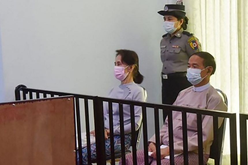 Detained civilian leader Aung San Suu Kyi (left) and detained president Win Myint during their first court appearance in Naypyidaw on May 24, 2021.