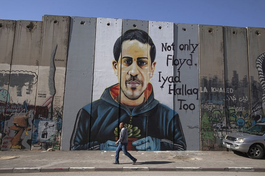 A mural shows Iyad al-Hallaq, who was shot and killed by an Israeli police officer, in the West Bank city of Bethlehem, on Nov 29, 2020.