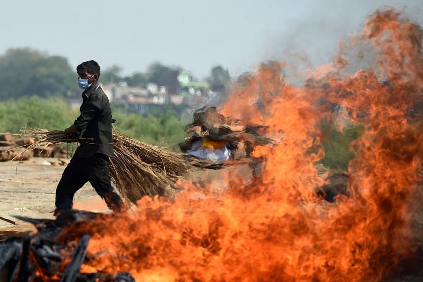 A burning funeral pyre of a Covid-19 victim at a cremation ground in Allahabad, India.