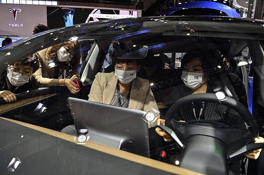 A Tesla Model Y car at the Shanghai International Automobile Industry Exhibition in April. Registrations of the China-made sport utility vehicle rose to 12,785 last month from 5,520 in April, despite a high-profile protest against Tesla at the Shangh
