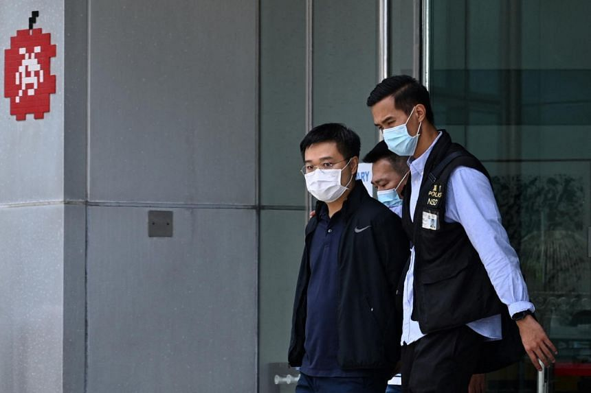 Police officers escorting Apple Daily editor-in-chief Ryan Law (centre) in Hong Kong, on June 17, 2021.
