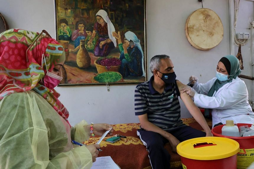 A Palestinian man receiving a vaccine shot in the village of Dura, near Hebron, in the West Bank, on June 9, 2021.