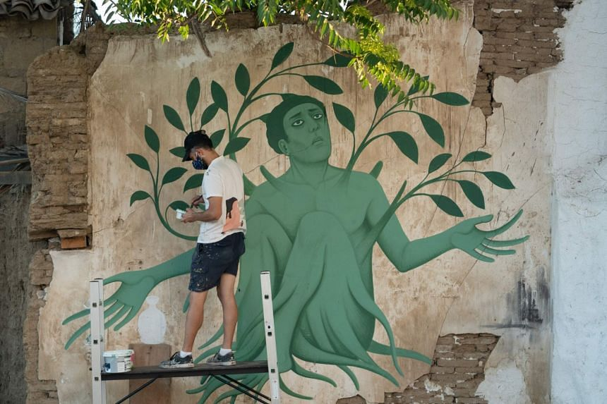 The works of Greek artist Fikos – which blend Greek mythology and Byzantine iconography with graffiti and street art – adorn the walls of the Cyprus capital of Nicosia. The 33-year-old (above) spends time wandering the narrow back alleys of the O