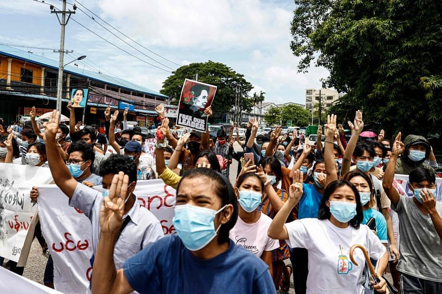 Protesters in Yangon on June 19, on the 76th birthday of detained civilian leader Aung San Suu Kyi.