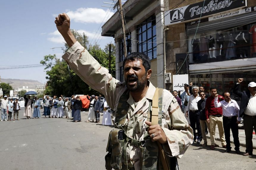 Houthi supporters shout slogans during an anti-US and Saudi rally in Sana'a, Yemen, on June 6, 2021.