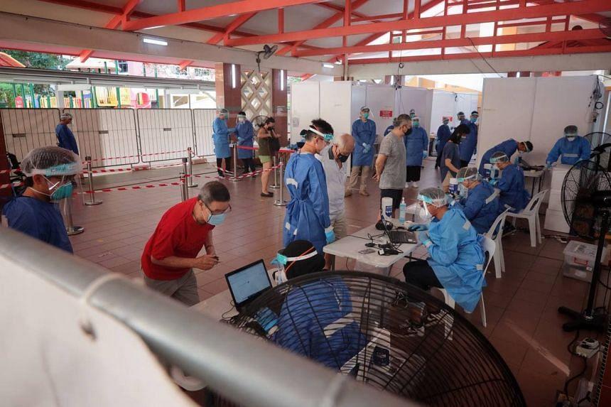 Swab testing for Bukit Merah View residents at Block 125A Bukit Merah View on June 20, 2021.