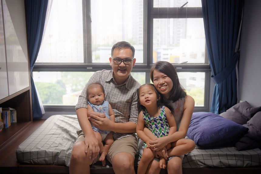 Mr Marcus Cheong and his wife, Si Lin, with their daughters, Matilda and Rebekah.
