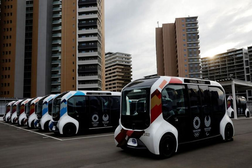 Electric vehicles at an internal shuttle bus station of the Tokyo 2020 Olympic and Paralympic Village in Tokyo.