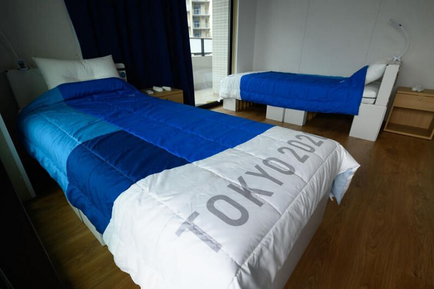 Recyclable cardboard beds and mattresses inside a residential unit for athletes at the Olympic and Paralympic Village in Tokyo.