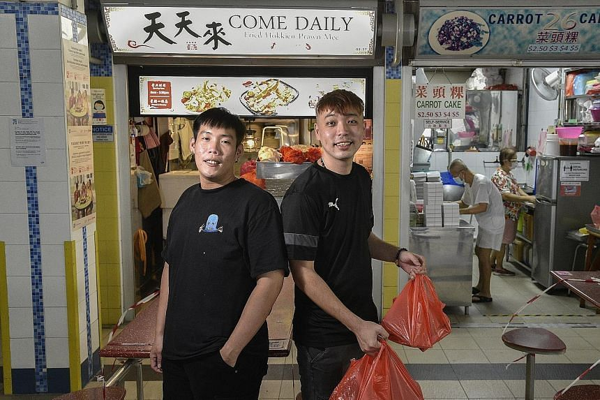 Hawker Jason Huang (left) roped in national service buddy Ronnie Tay, a private-hire driver, to make food deliveries.