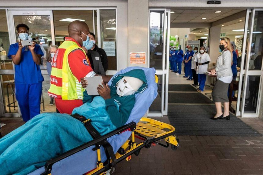Rodwell Khomazana is taken into the hospital on a gurney at a clinic in Sandton, Johannesburg, on June 19, 2021.