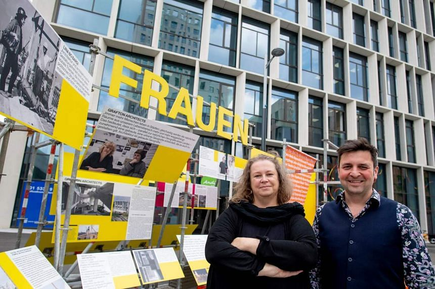 """Katja Schechtner (left) and Wojciech Czaja, curators of the architecture exhibition """"Women build the city"""", pose for a picture in Seestadt, Vienna, on June 8, 2021."""