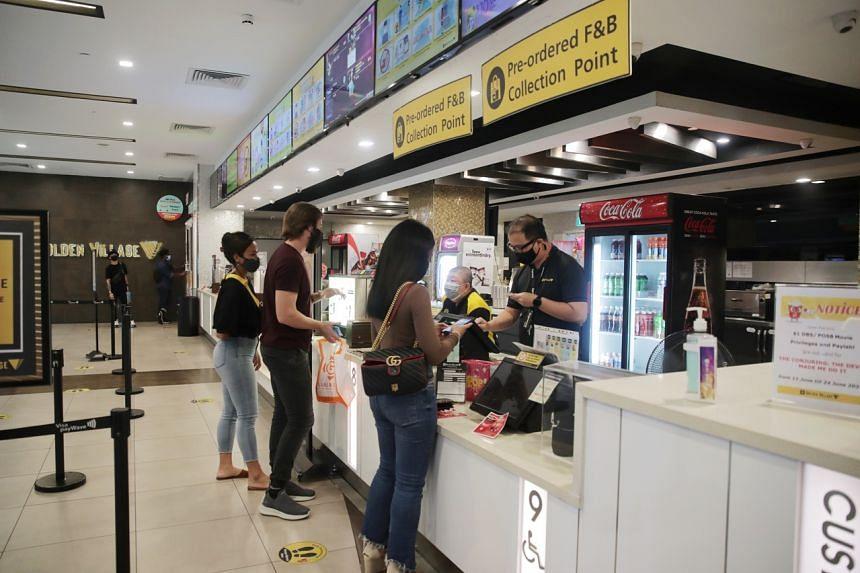 Movie-goers seen buying tickets at GV cinema in Plaza Singapura on June 19, 2021.