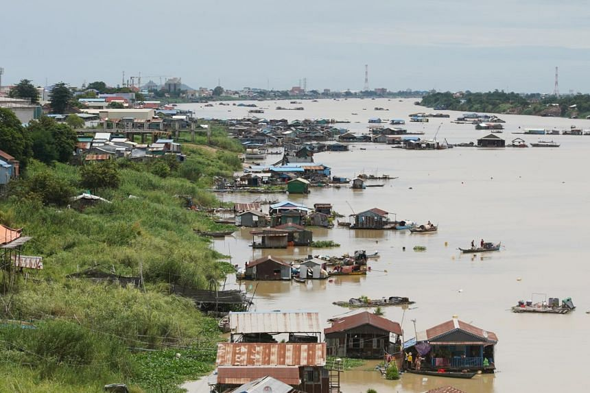 The conservationists were detained while documenting run-off into the Tonle Sap river (above) in Phnom Penh.