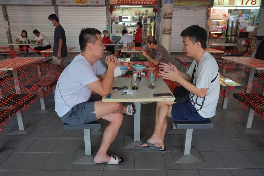 Diners at Tiong Bahru Market and Food Centre on June 21, 2021.