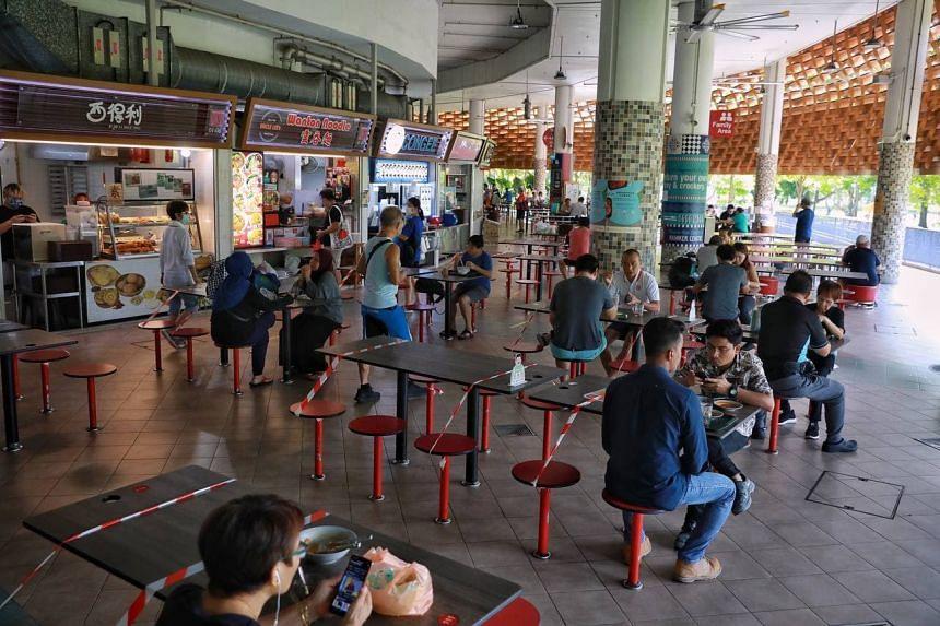 People having breakfast at Pasir Ris Hawker Centre on June 21, 2021.