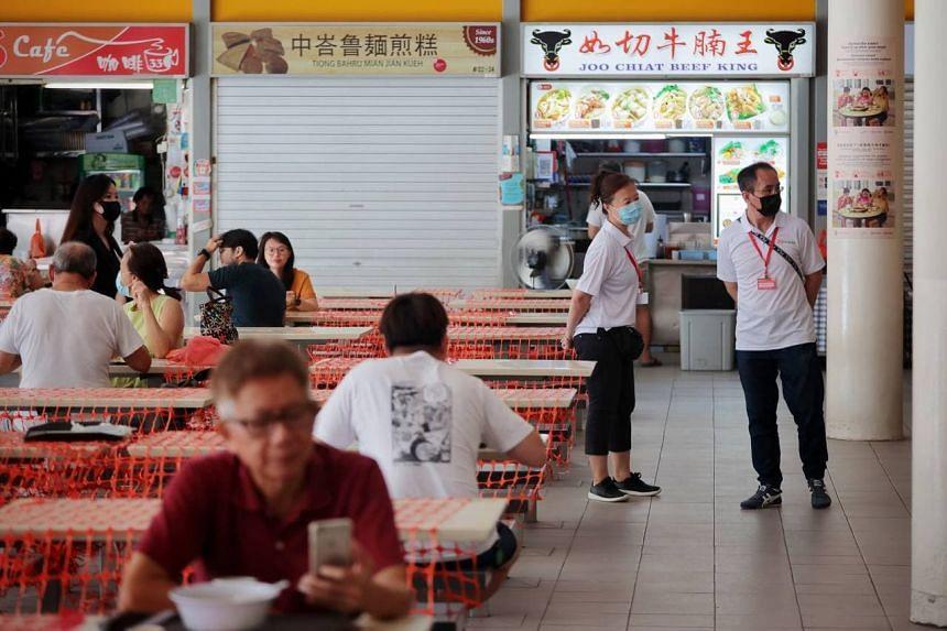 Safe distancing ambassadors at Tiong Bahru Market and Food Centre on June 21, 2021.