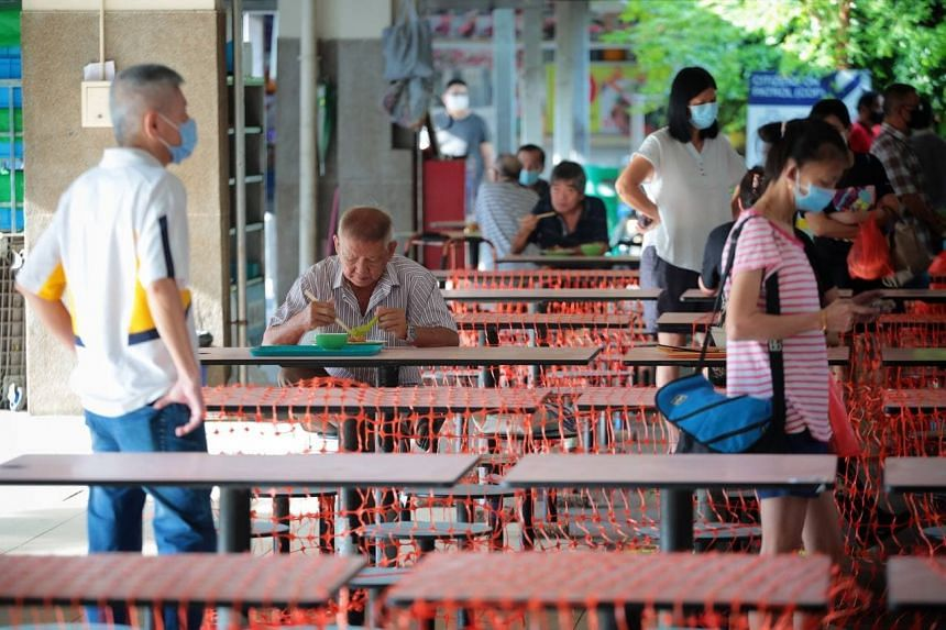 Diners at 11 Telok Blangah Crescent food centre at around 9am on June 21, 2021.