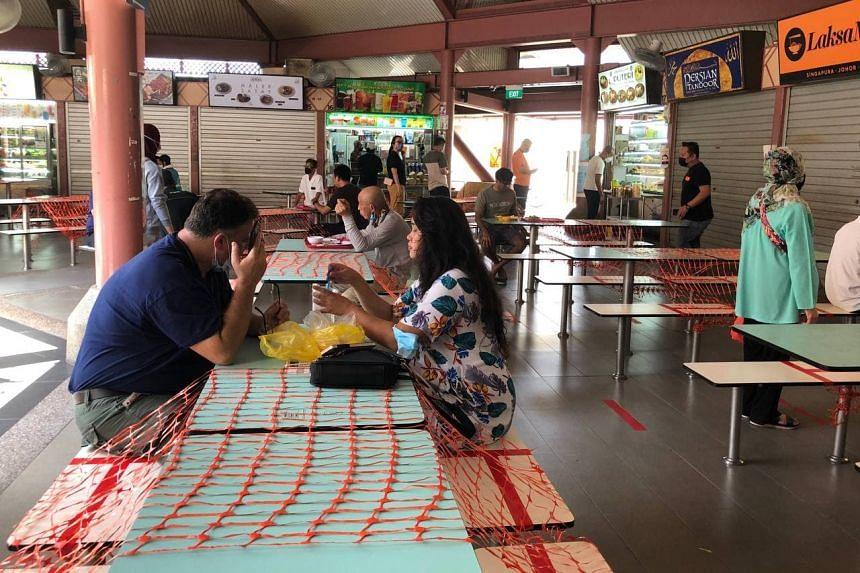 Diners at Bedok Corner Food Centre on June 12, 2021.