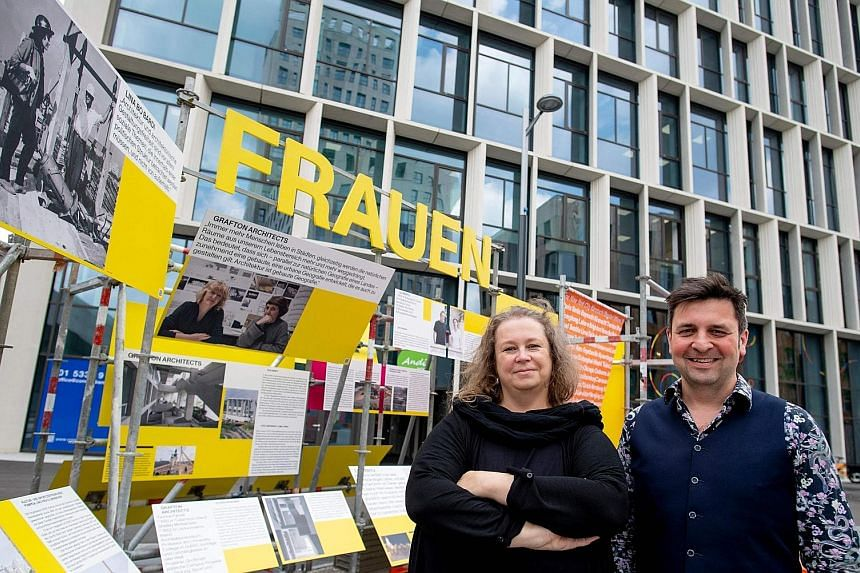 Curators Katja Schechtner (far left) and Wojciech Czaja at their Women Build The City exhibition in Seestadt, Vienna. It shows the achievements of 18 female architects, artists and urban planners from across the world.