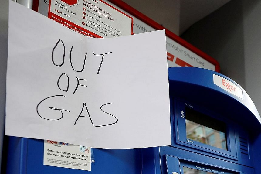 """An """"out of gas"""" sign displayed at an Exxon petrol station in Washington last month, after a cyber attack shut down Colonial Pipeline, the biggest fuel pipeline in the United States. PHOTO: REUTERS Above: Colonial Pipeline's Houston Station facility i"""