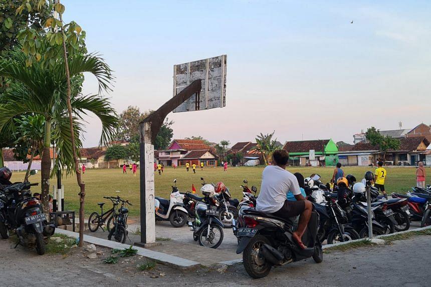 People playing football in Bantul regency, a high-risk Covid-19 red zone, in Yogyakarta.