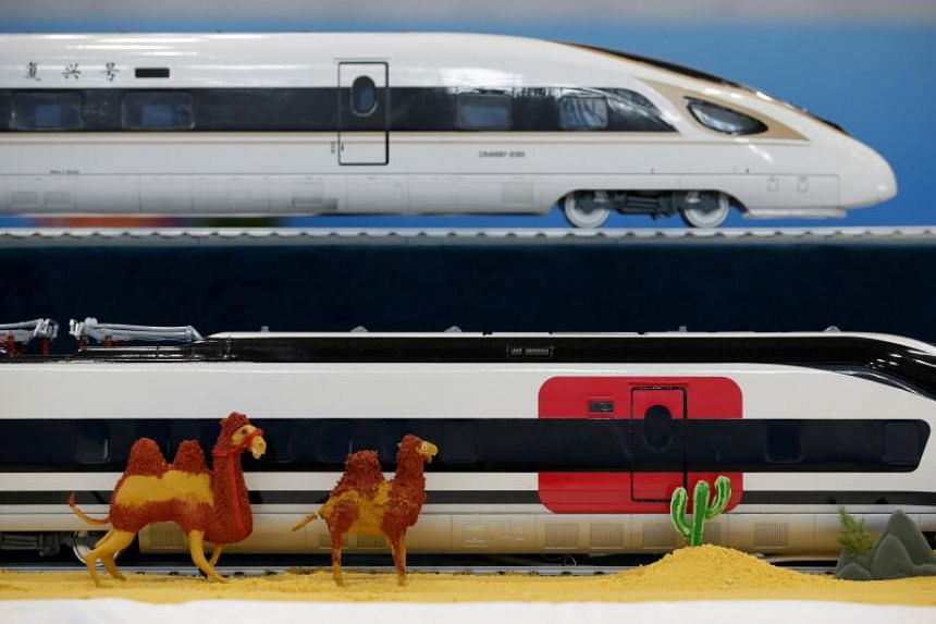 A photo from April 26, 2019, shows a replica of China Railway High-speed trains at a media centre for the second Belt and Road Forum in Beijing.